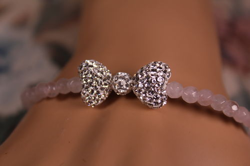 Sterling Silver and Cubic Zirconia Bow Bracelet with Pink Translucent Beads