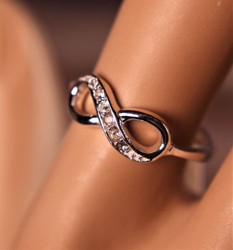 Sterling Silver Infinity Ring with Sparkling White Crystal Adornments