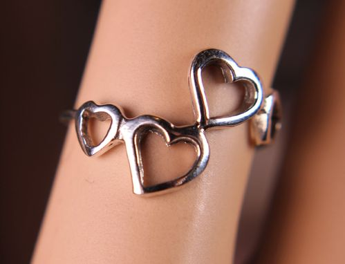 Sterling Silver Hearts Ring Four Heart Silhouettes Dancing